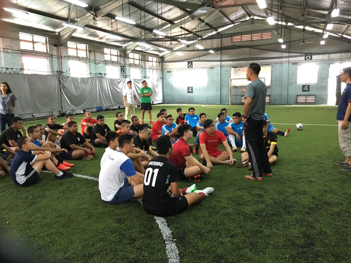 Youths being briefed before their game at the Rochor Annual Futsal Tournament 2015.